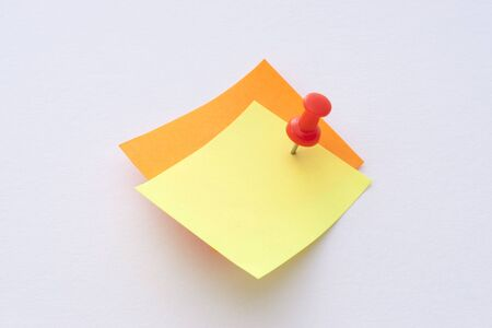 Colorful note papers with push pin on white background photo