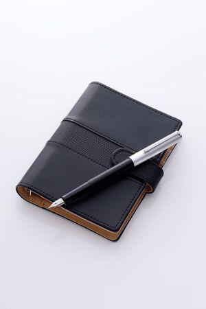 black pocket diary and pen Stock Photo - 12856841