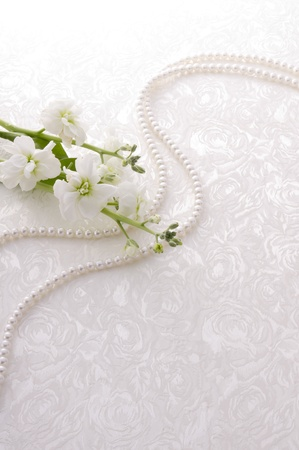 small white flower and pearl on white cloth Stockfoto