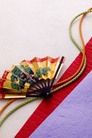 Japanese fan and kimono cords on japanese papers photo