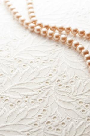 真珠の背景画像に白いレース 写真素材