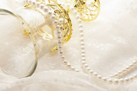 beautiful glass and pearl nacklace on lace cloth photo