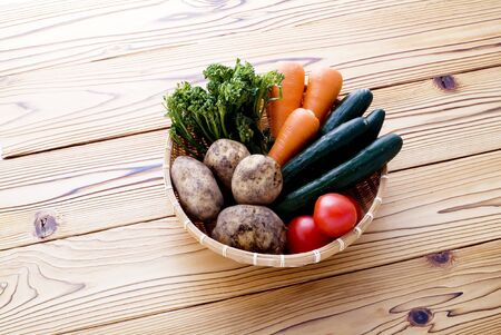 various fresh vegetables in bamboo basket photo