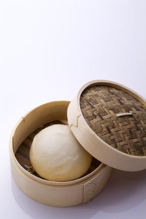 豚のセイロを使った中華料理 写真素材
