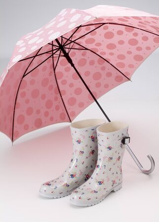 cute umbrella and rubber boots of rainy day  photo