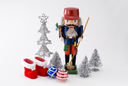 nutcracker and christmas ornament on white background photo