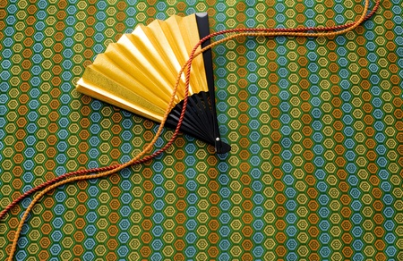 Japanese image of japanese fan on kimono texture Stock Photo - 13104590