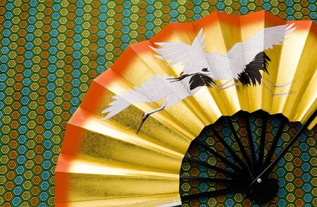 Japanese image of japanese fan on kimono texture