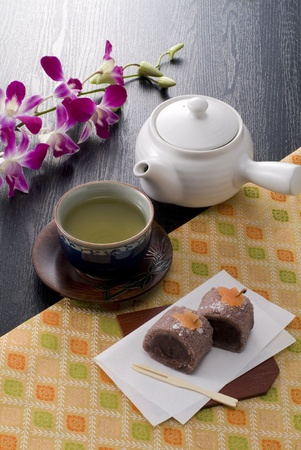 japanese hot tea, confectionery, and tea pot on japanese paper