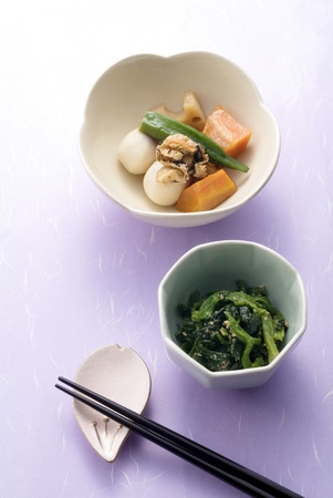 japanese food and chopsticks on japanese paper photo