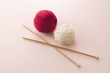 ball of yarn on pink background photo