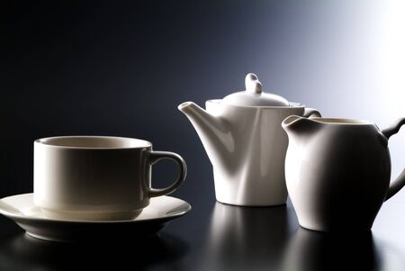 coffee cup , pot and milk on black background Stockfoto