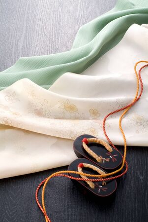 Japanese wodden clogs, cords and japanese wrapping cloth photo