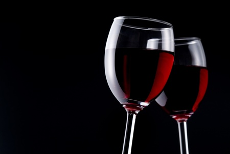 cheers: Red wine on black background Stock Photo