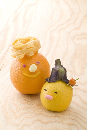 Cute orange and lemon on woody background Stock Photo - 13130635