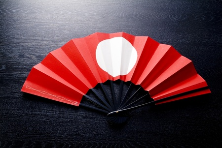 woody: Japanese celebrate fan on black woody background