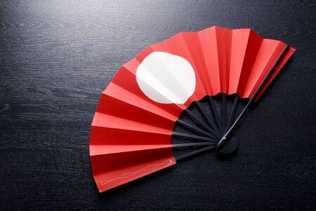 japanese ethnicity: Japanese celebrate fan on black woody background