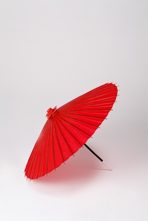 Japanese oil-paper umbrella isolated on white background photo