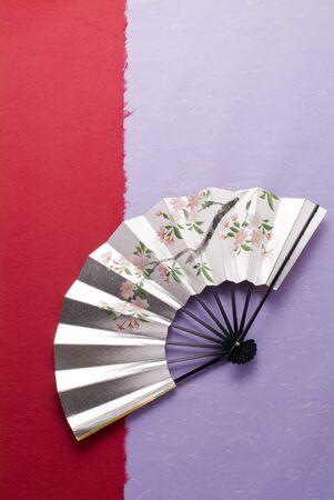 cerebrate: Japanese image, Japanese fan on japanese paper Stock Photo
