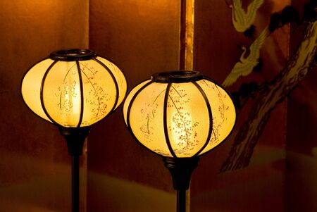 Japanese lantern in front of gold folding screen photo