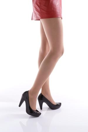skirts: Una joven mujer asi�tica en usar faldas cortas de color rojo.
