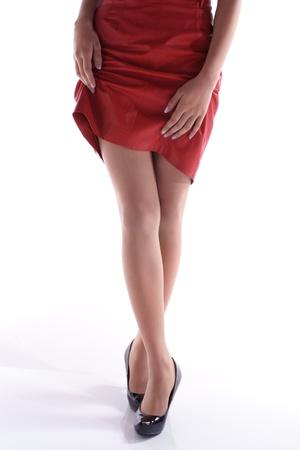 tacones rojos: Una joven mujer asiática en usar faldas cortas de color rojo