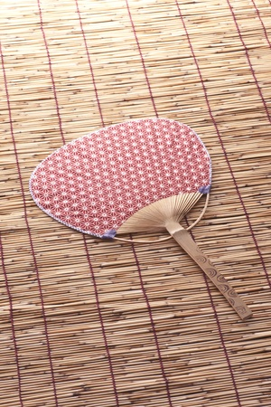 Japanese fan and bamboo blind are necessities for feel coolness  in japanese summer  photo