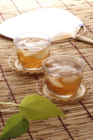 Japanese often drink cold berley tea , and  fan themselves by japanese fan in summer