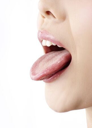 female tongue: A young woman is sticking her tongue. Stock Photo