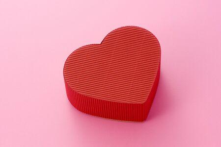 Isolated heart-shaped gift box  photo