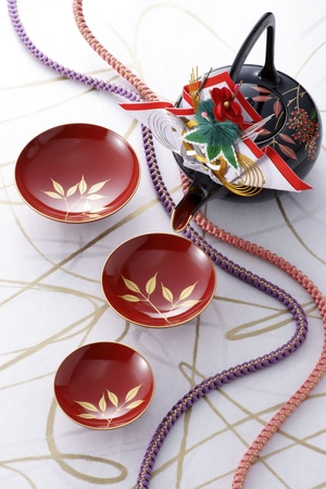 Japanese New Year's sake up and pot by japanese cords on elegant japanese paper Stock Photo - 13237898