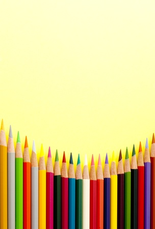 Colored pencils on the yellow background Stock Photo - 13237846