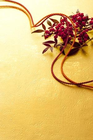 Japanese background of kimono cords and Heavenly bamboo Stock Photo - 13237938