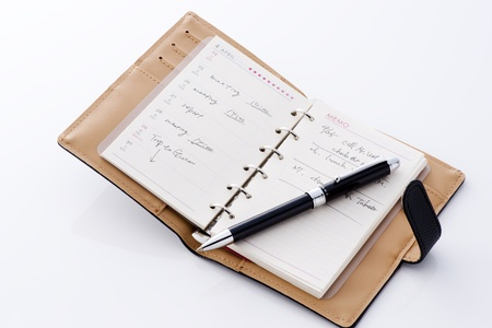 Opened notebook and a pen for office workers photo
