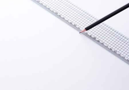 Plastic ruler and pencil for drawing  photo