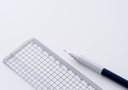 Plastic ruler and technical pencil for drawing photo