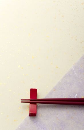 red chopsticks on japanese paper photo