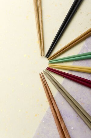 various colorful chopsticks on japanese paper photo
