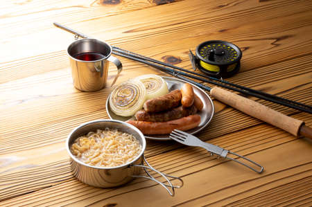 Camp Cooking Sausages and Instant Noodles 写真素材