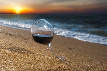 beach bar: glass of wine on sunset