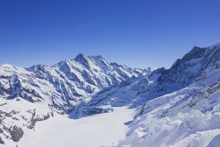 snowcovered: Snow-covered mountain in swiss alps