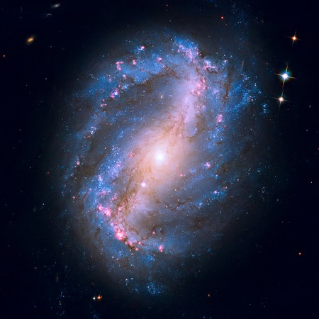 NGC 6217 is a barred spiral galaxy located some 67 million light years away, in the constellation Ursa Minor. Retouched image.