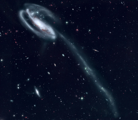 The Tadpole Galaxy is a disrupted barred spiral galaxy in the northern constellation Draco. Retouched image.
