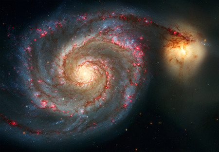 Whirlpool Galaxy and Companion. Winding arms of the spiral galaxy M51 or NGC 5194 appear like a grand spiral staircase sweeping through space.