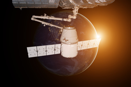 SpaceX Dragon orbiting the planet Earth. Reklamní fotografie