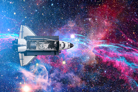 Space Shuttle flight over space stars, galaxies and nebula. Elements of this image furnished by NASA. Stock Photo
