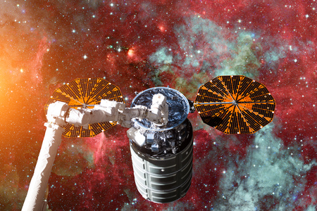 Cargo spacecraft - The Automated Transfer Vehicle over spiral galaxy. Elements of this image furnished by NASA. Stock Photo