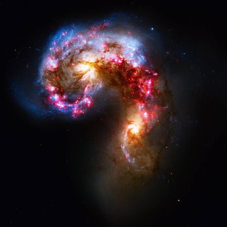 corvus: The Antennae Galaxies or NGC 4038 or NGC 4039 are undergoing a galactic collision. Located in the constellation Corvus. Elements of this image furnished by NASA.