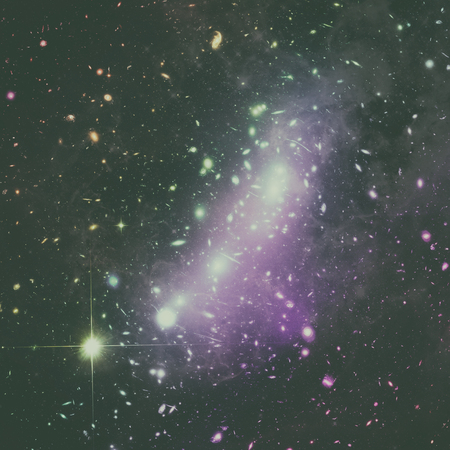 Cosmic kaleidoscope of galaxy clusters, forming a single object known as MACS J0416. It is located in the constellation of Eridanus. Elements of this image furnished by NASA.