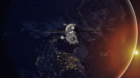 orbiting: Spacecraft Progress orbiting the earth. Elements of this image furnished by NASA.